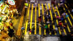 HONG KONG - October 2015: People crossing street in the evening. 4K time lapse. Stock Footage