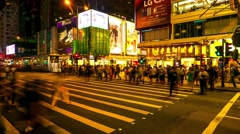 HONG KONG- Traffic and people crossing street in city centre at night. 4K Stock Footage