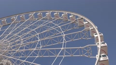 Hong Kong - Ferris wheel close up with aeroplane passing by. Flat profile Stock Footage