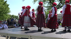 Girls in national dress dance in circle and people audience. 4K Stock Footage