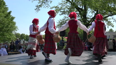 Girls with traditional clothes dancing holding hands in hands . 4K Stock Footage