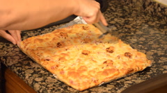 Square Pizza Devided Into Bits - stock footage