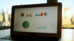 looking at charts diagrams on laptop screen display analyzing business growth - stock footage