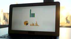Analyzing charts and diagrams on laptop computer screen. financial business desk Stock Footage