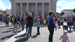 Families participate in bubble blow parade. 4K Stock Footage