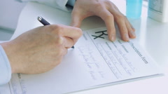 Doctors hand writting rx prescription Stock Footage