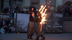 Woman perform spectacle with fire fan in square outdoor. 4K Stock Footage