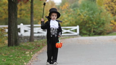 Cute boy in the park, wearing magician costume for Halloween, having fun Arkistovideo