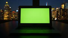Isolated green screen on laptop computer display. modern office desk table view Stock Footage