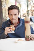 Man drinking Mate - stock photo