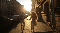 The guy running after a girl in the street Stock Footage