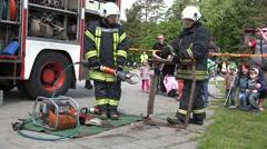 Fireman demonstrate rescue equipment near firefighter truck. 4K Stock Footage