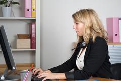 Woman looking at the camera at work Stock Photos