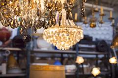 Luster on a flea market with other ceiling lights Stock Photos