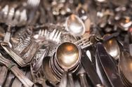 Stock Photo of bunch of old silver ware on a flea market