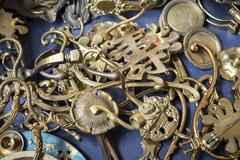 Bunch of many old brass door mountings on a flea market Stock Photos
