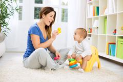 Baby growing up and leaving diapers - stock photo