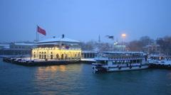 Kadikoy Pier under snow on night - stock footage