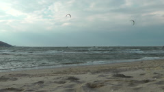 Zoom in And Pan shot of Kitesurfing on the beach, Sandy HOOK area - stock footage