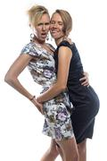 Isolated portrait of joking sisters on white - stock photo