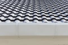 white gutter on the roof top of house - stock photo