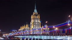 Hotel Ukraine winter night timelapse hyperlapse with bridge over Moscow River Stock Footage