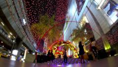 BANGKOK - People walking in glowing tunnel in the night. Siam Paragon. 4K Stock Footage