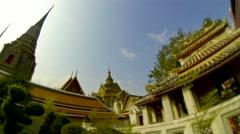 BANGKOK - March 2015: Wat Pho temple against blue sky. 4k resolution tilt shift - stock footage