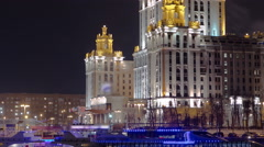 Hotel Ukraine winter night timelapse hyperlapse with ship on Moscow River Stock Footage