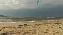 Kitesurfing on the beach, Sandy HOOK area. It was cloudy and chilly day, but som Stock Footage