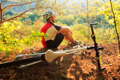 Mountain Bike cyclist resting outdoor - stock photo