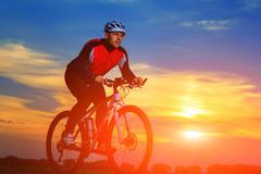 Cyclist Riding the Bike Stock Photos