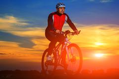 Cyclist Riding the Bike Stock Photos