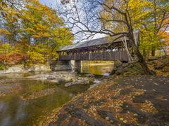 Old covered bridge during the fall season Stock Photos