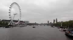 Ferris wheel in London, a boat sailing on the accelerated shooting, timelaps - stock footage