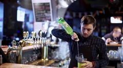 Young bartenderpreparing coctail with shaker Stock Footage