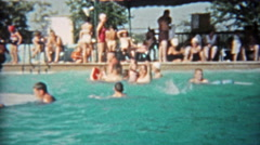 1959: People of all ages playing in public pool during a hot summer day. Stock Footage