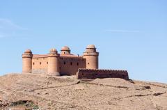 Castle on hilltop above La Calahorra Spain Stock Photos