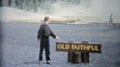 1959: Old faithful geyser in Yellowstone park family vacation visit. Stock Footage