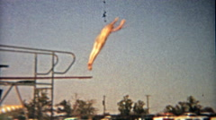 1959: High hotel diving board to swimming pool clips mastered by child waterman. Stock Footage