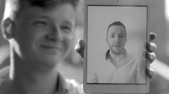 two young casual man having a video chat conversation using mobil tablet pc - stock footage