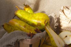 Green pears on a sackcloth Stock Photos