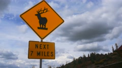 Elk Caution Sign on Mountain Road, 4K Stock Footage