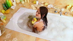 Young woman take bubble  bath. Top view Stock Footage