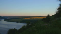 Hills over river at sunrise Stock Footage