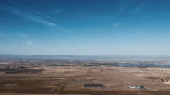 Stock Video Footage of Aerial of arid farmland with mountains behind, 4K
