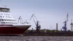 Large passenger ferry to the port crane working in the background. Close-up Stock Footage