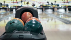 Varicolored bowling balls at the bowling club, close up Stock Footage