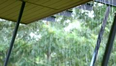 Stock Video Footage of Streams of rain water pour off a corrugated roof