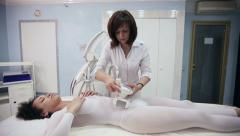 Girl is massaged for reducing cellulite with electronic massage system Stock Footage